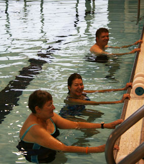 staff and 2 adults exercising at Fitness Swim program